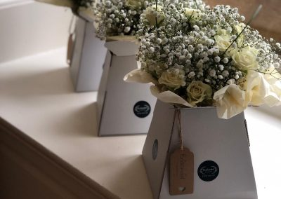 white bridesmaids bouquets_white_winter_bridesmaid_Enchanted Floristry_Eynsham Hall
