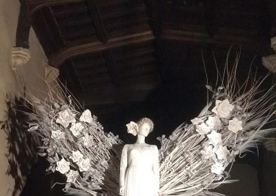 close up of angel wings at Witney Wonderland_white_winter_backdrop_Enchanted Floristry_St Mary's Church