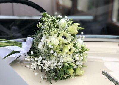 bouquet on vintage car_white_spring_bouquet_Enchanted Floristry_Enchanted Carriages